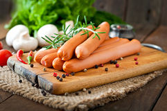 Sausage. On a wooden background stock photo