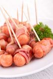 Sausage wrapped in bacon Royalty Free Stock Photo