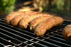 Sausages. Grilled sausages put in a row Royalty Free Stock Images