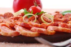 Sausages. Closeup of sausages on wooden plate stock photos