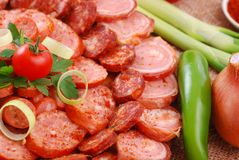 Sausages. Closeup of various sausages with vegetables stock images