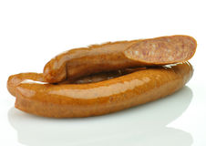 Sausages. Raw sausages on a white background royalty free stock photo