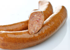 Sausages. Raw sausages on a white background stock image