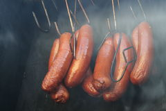 Sausages. The tasty sausages prepare in a smoke-mox Royalty Free Stock Photos