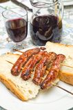 Sausages. Roasted skewers of sausage on the table Stock Photography