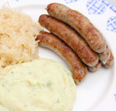 Sausages. Some fresh grilled sausages with cabbage Royalty Free Stock Image