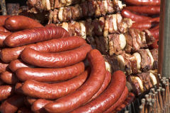Sausages. A view of juicy sausages stacked up in a meat shop Stock Image