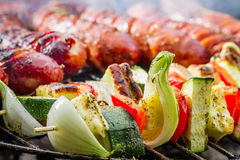 Sausages And Skewers On The Grill Royalty Free Stock Photos