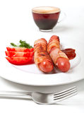 Sausages in bacon, coffee, tomatoes Royalty Free Stock Images