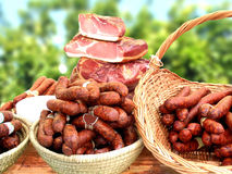 Sausages and bacon. On the table stock images