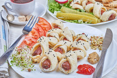 Sausages baked in a puff pastry Stock Photos