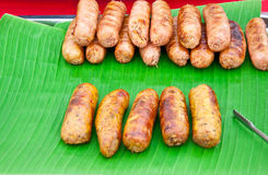Sausages on banana leaves. Royalty Free Stock Photography