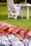 Sausages on a barbecue Royalty Free Stock Images