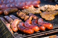 Sausages on barbecue Royalty Free Stock Photography