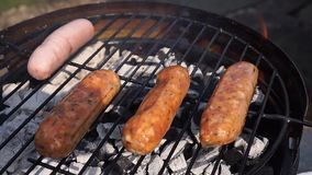 Sausages on barbecue stock video footage