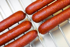 Sausages on barbecue grill. Meat sausages on barbecue grill, picnic Royalty Free Stock Image