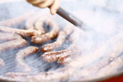 Sausages on barbecue grill Royalty Free Stock Images