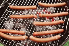 Sausages on barbecue grill Stock Images