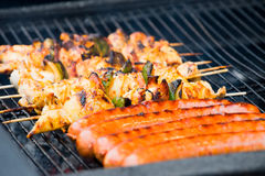 Sausages and barbecue on a open air Stock Photo