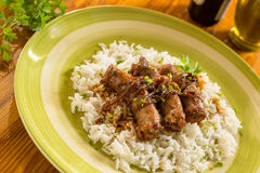 Sausages with basmati risotto Stock Photo