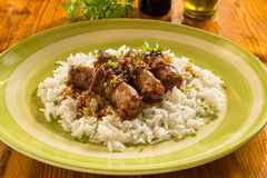 Sausages with basmati risotto Stock Photography