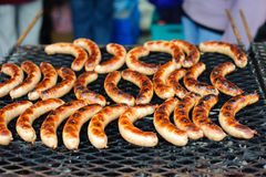 Sausages on the BBQ. Hot sausages on the BBQ stock image