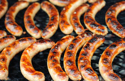Sausages on the BBQ. Hot sausages on the BBQ Royalty Free Stock Images