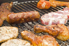 Sausages, beef and other meat on a barbecue Royalty Free Stock Photo
