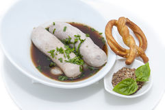 Sausages in beer sauce Stock Image