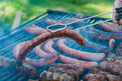 Sausages being grilled Stock Image