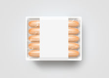 Sausages in blank white plastic disposable box mockup, isolated, Royalty Free Stock Images