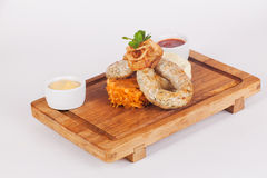 Sausages with braised cabbage, wooden board royalty free stock photos
