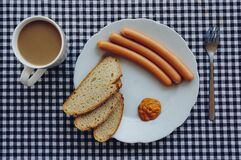 Sausages, Bread and Coffee on Table Stock Image