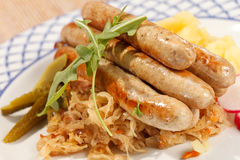 Sausages with cabbage royalty free stock photography