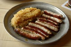 Sausages with cabbage. Stock Image