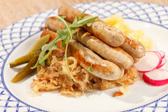Sausages with cabbage Royalty Free Stock Images