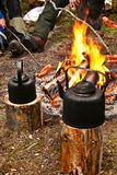 Sausages on campfire. Cofee and sausages prepared on fire Stock Photos