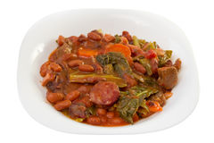 Sausages with carrot, beans and cabbage Royalty Free Stock Image