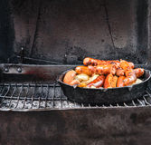 Sausages in cast iron skillet Stock Images