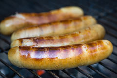 Sausages on charcoal grill Royalty Free Stock Photos