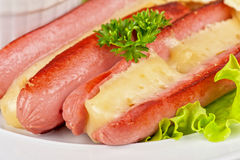 Sausages with cheese and omelette Royalty Free Stock Photo