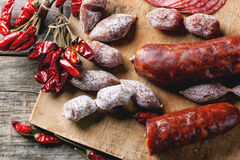 Sausages and chili peppers Stock Photos
