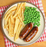 Sausages with Chips and Peas Royalty Free Stock Photography