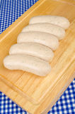 Sausages on chopping board Stock Image