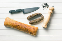 Sausages, ciabatta, knife and pepper mill Royalty Free Stock Image