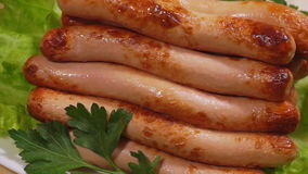 Sausages cooked on the grill. stock video footage