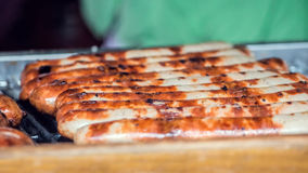 Sausages Cooking On Grill. Street Food Market Vendor Royalty Free Stock Image