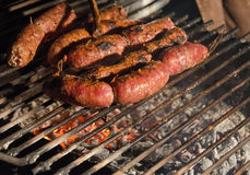 Sausages cooking on the grill Stock Photos