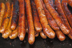 Sausages. Cooking on an outdoor grill Stock Photography