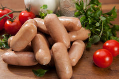 Sausages on cutting board Royalty Free Stock Photos